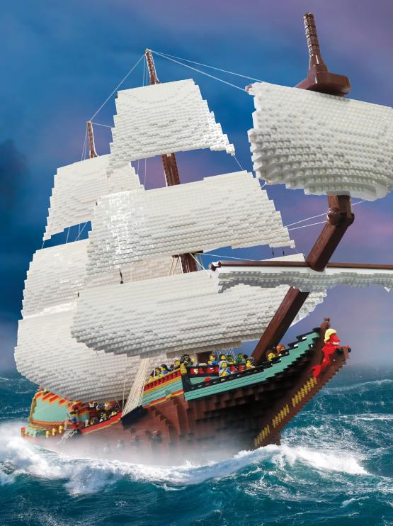 A poster featuring a LEGO ship sailing on the ocean