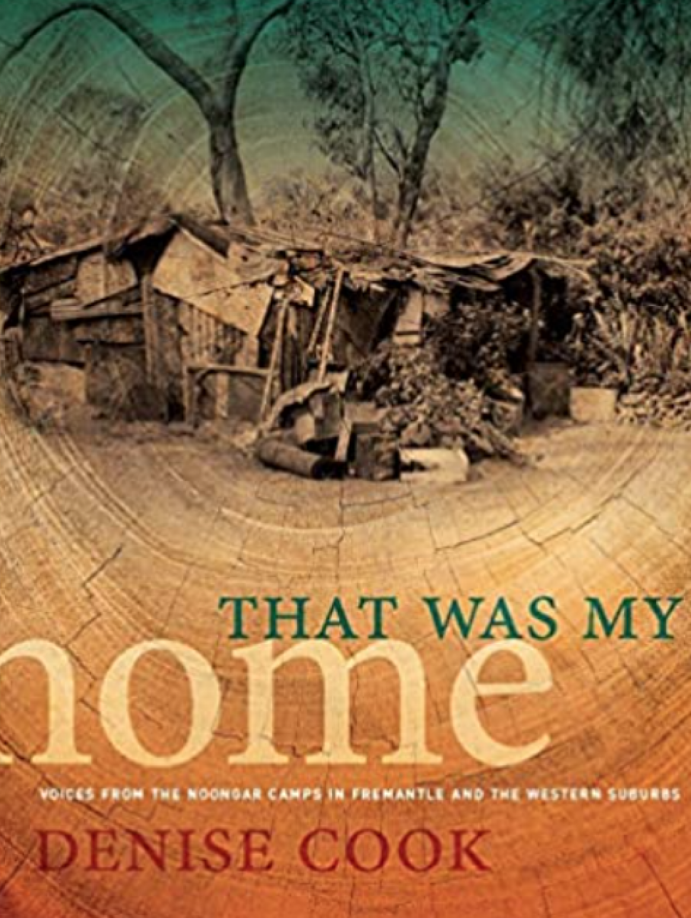 An image of the cover of a book 'That was my home' by Denise Cook, featuring a photograph of a camp surrounded by trees