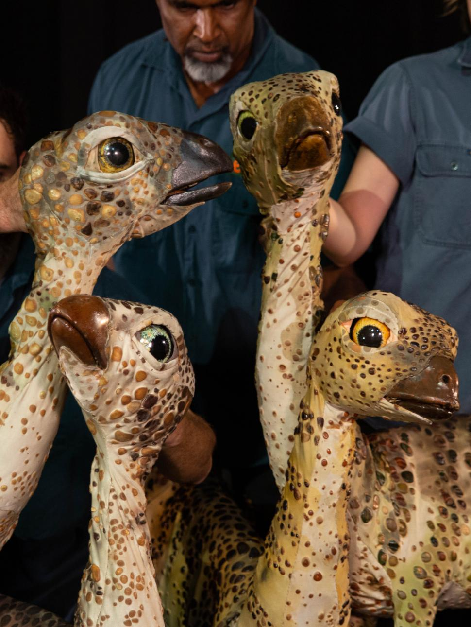 Puppeteers from Erth's Dinosaur Zoo pose with a group of dinosaur puppets